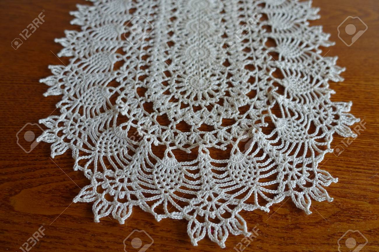 Close Up Of Oval White Crochet Lace Hanmdmade Doily On Wood Stock