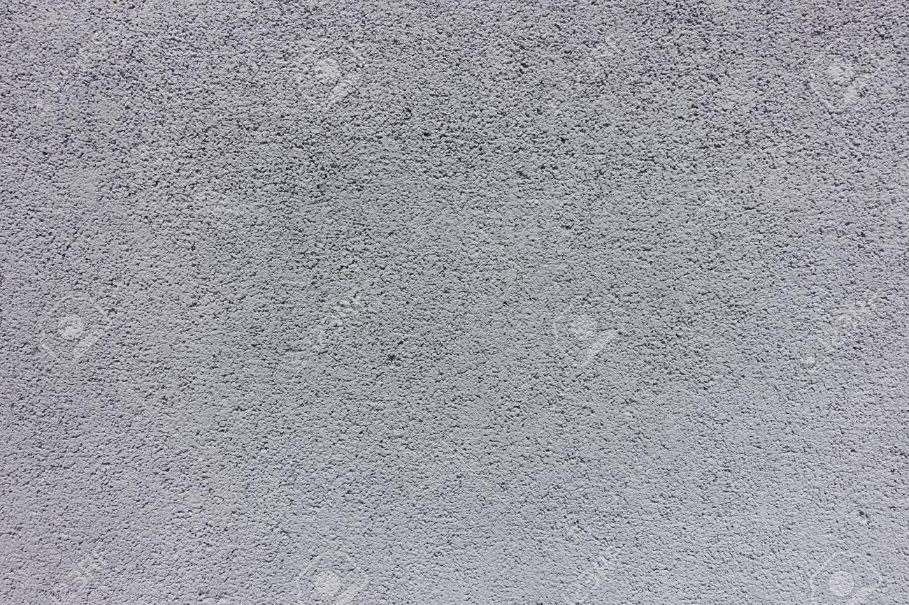 Texture de mur en béton peint en gris gris clair