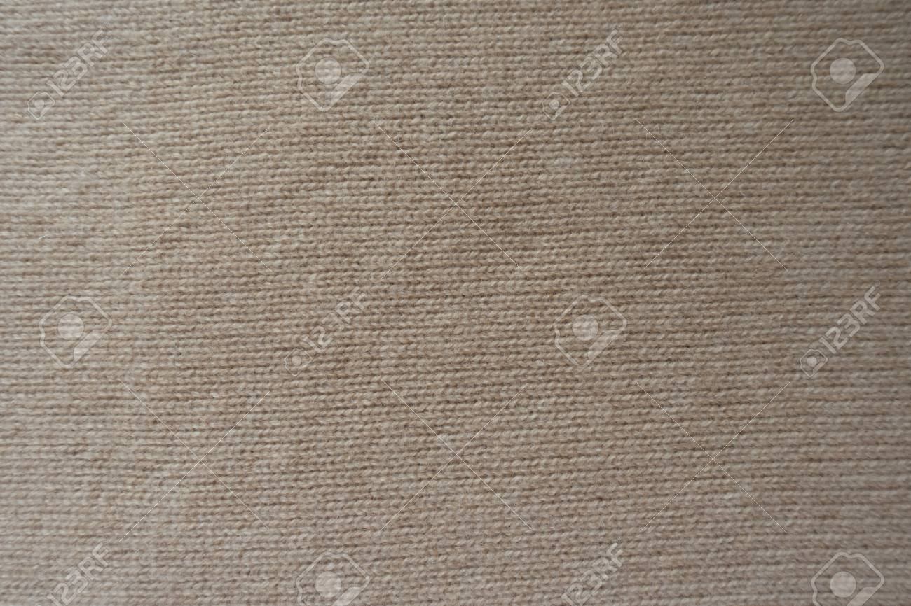 Background - simple beige knitted fabric from above - 126418537