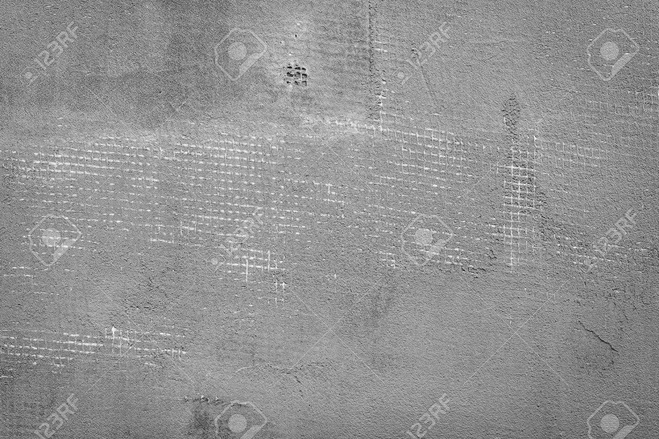 Splitted and cracked dark grey concrete wall with net and holes textured  cement background Stock Photo. Splitted And Cracked Dark Grey Concrete Wall With Net And Holes