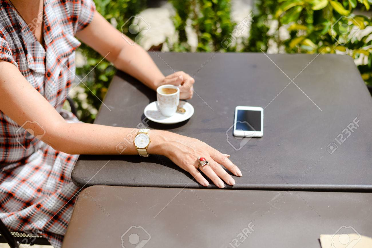 Top side view of woman using smartphone coffee table background top side view of woman using smartphone coffee table background closeup lifestyle photography geotapseo Choice Image