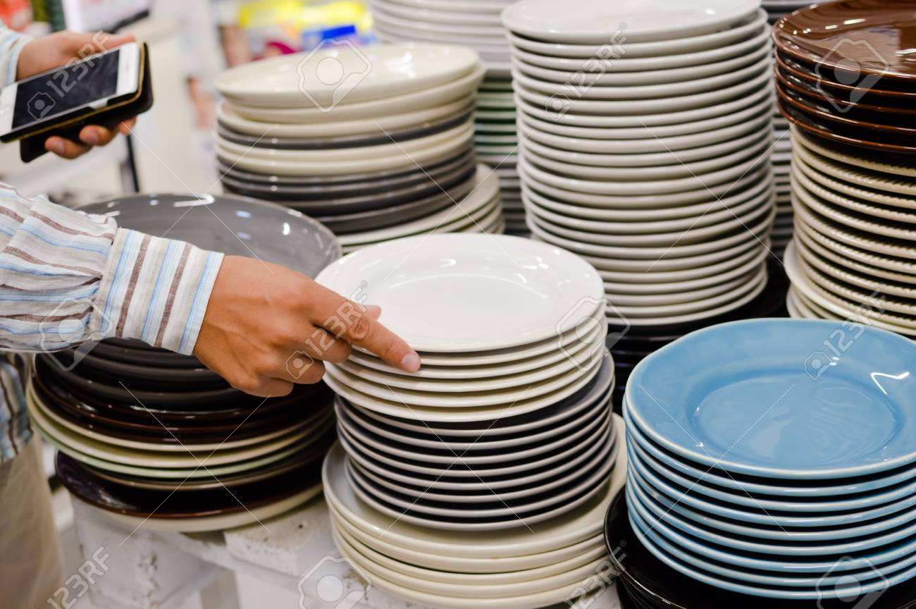 Close up image of person choosing selecting plates on the indoors background. Buying checking & Close Up Image Of Person Choosing Selecting Plates On The Indoors ...