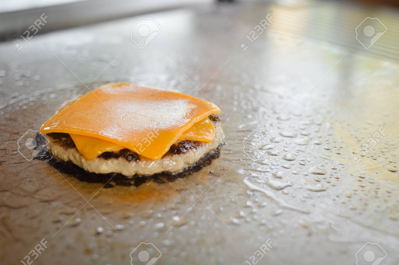 Burger On A Stove Background Cooking Delicious Hamburger Cheeseburger Stock Photo Picture And Royalty Free Image Image 96005396