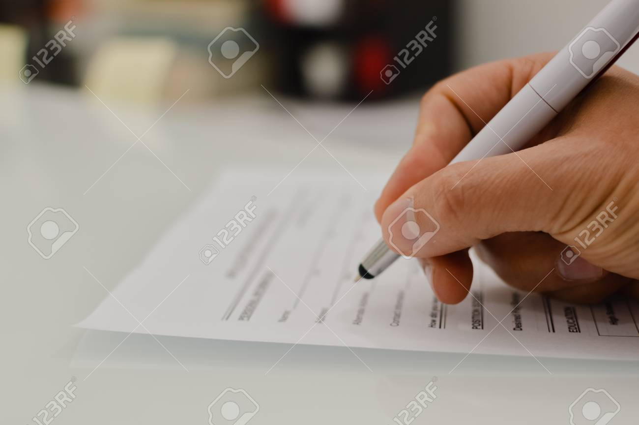 Closeup Of Hand Writing Filling Job Or Service Application Form ...