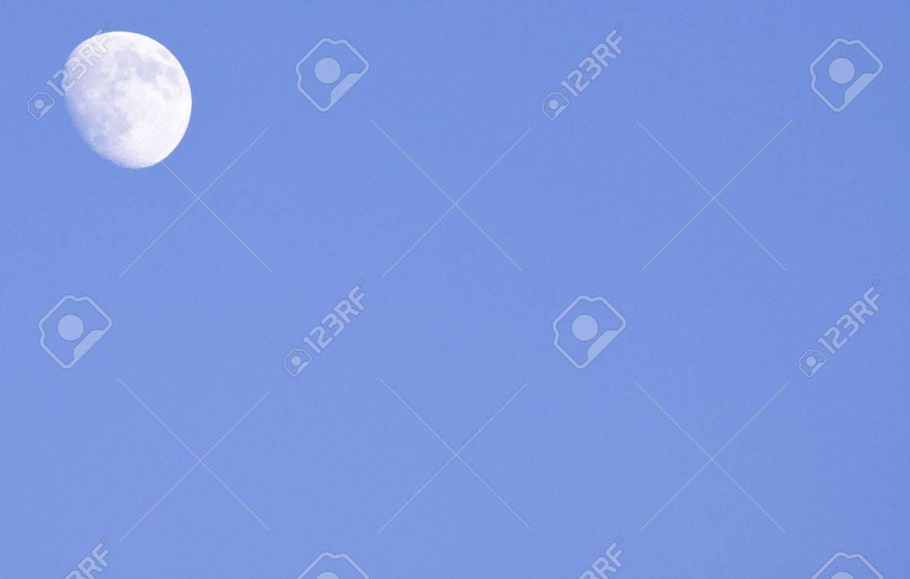 Moon in upper left corner by blue skies Stock Photo - 6178633