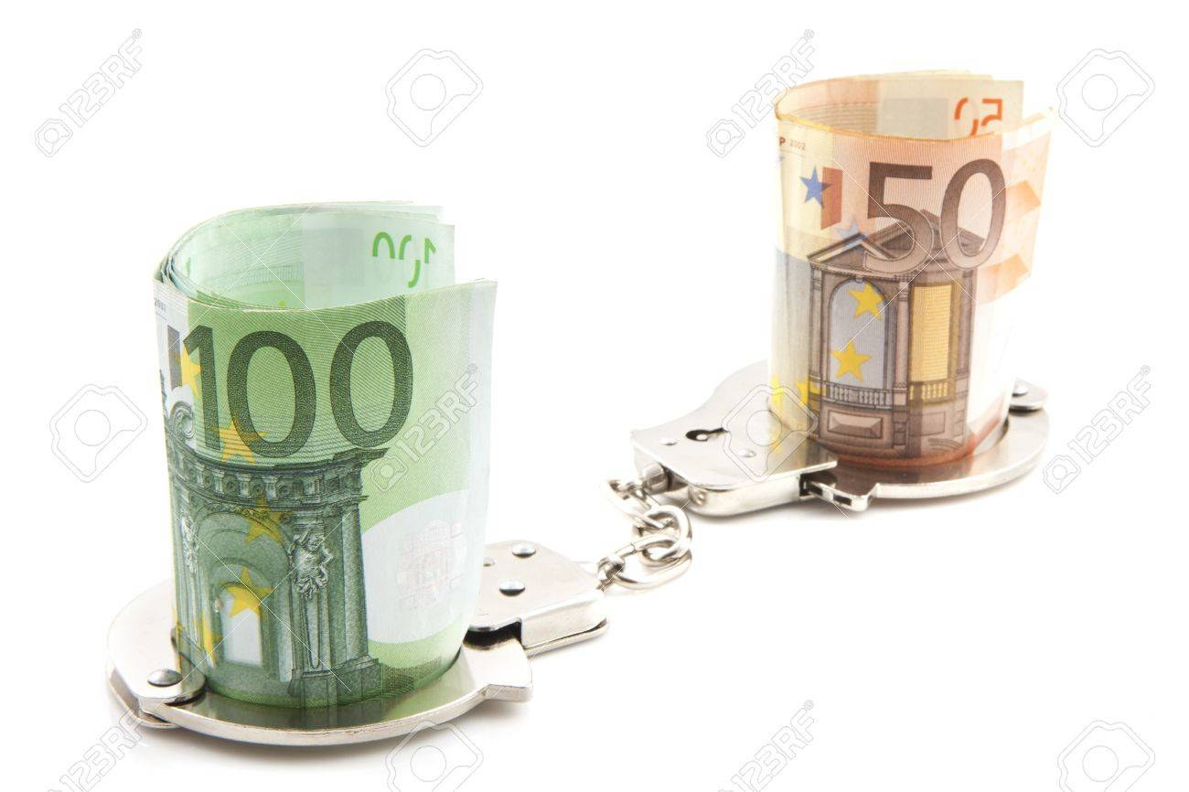 Money in handcuffs on a white background Stock Photo - 11108203