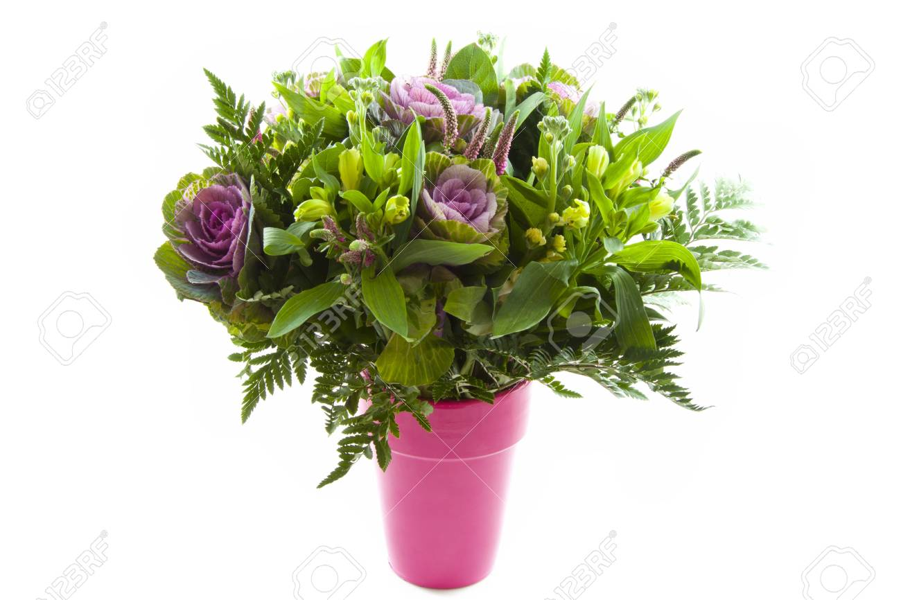 Bouquet of flowers in a pink vase over white Stock Photo - 11534801