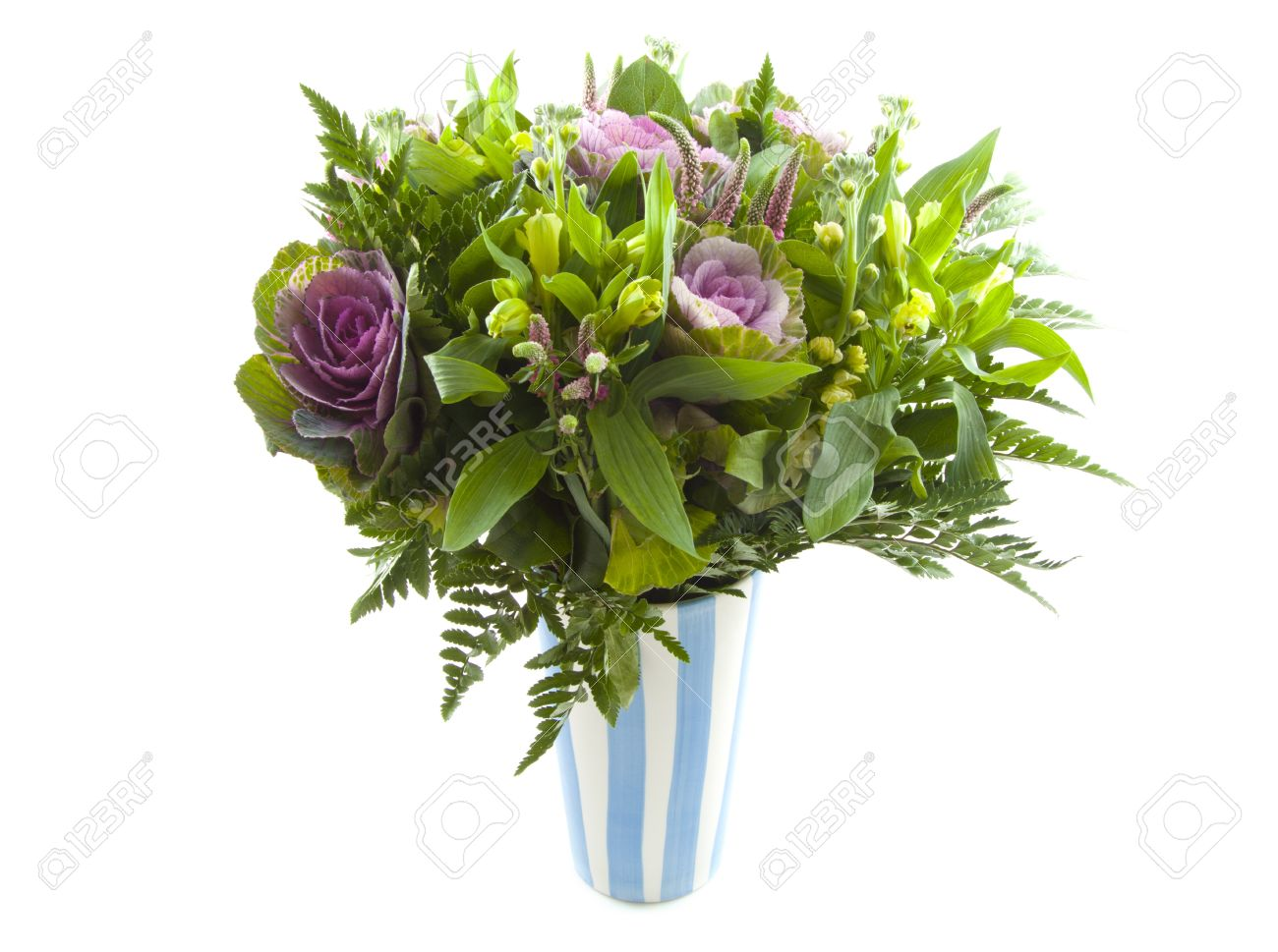 Bouquet with different kind of flowers in blue white vase over white Stock Photo - 11864460