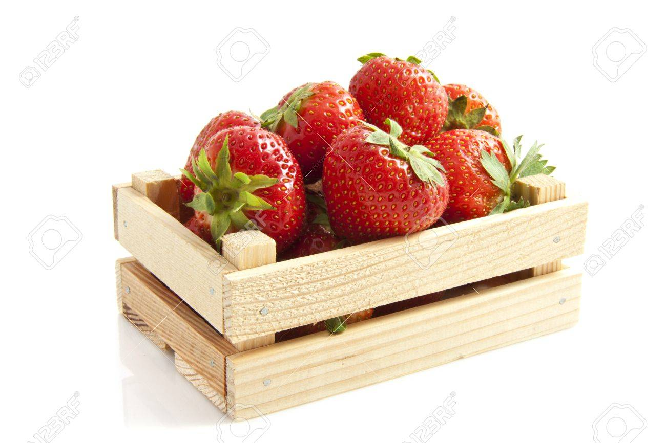 Delicious strawberries in wooden crate over white Stock Photo - 11864499