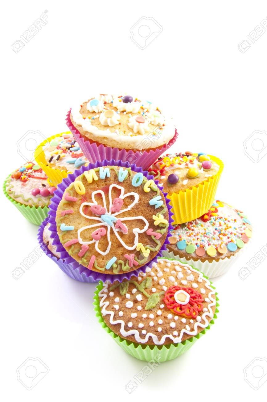 Colorful decorated cupcakes on a pile over white Stock Photo - 12173554