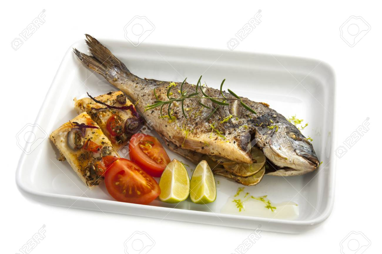 oven cooked fish dorade with bread an spices stock photo picture