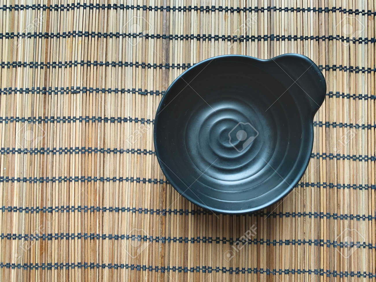 Wooden napkin with black cup. View from above. - 169603139