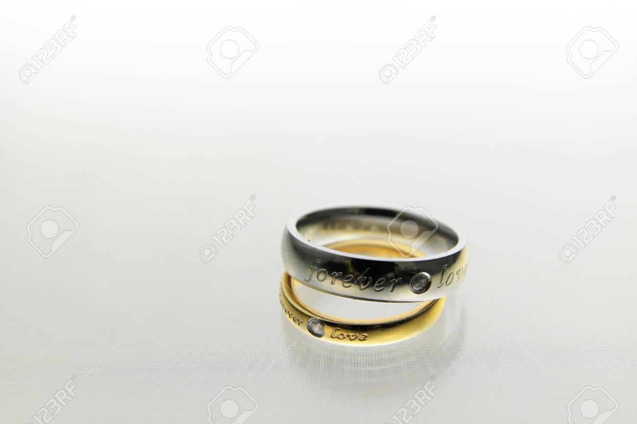 Wedding rings on the white background Stock Photo - 12732880
