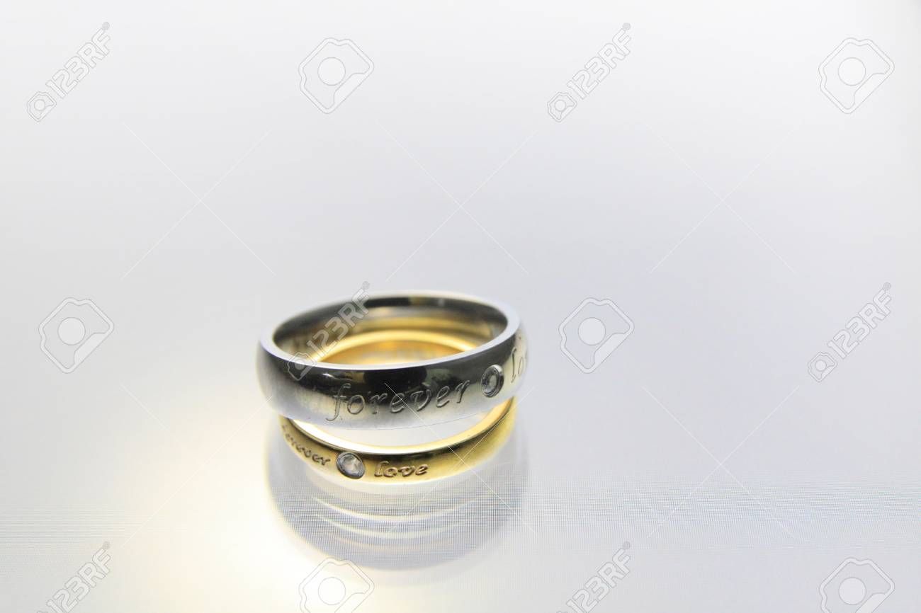 Wedding rings on the white background Stock Photo - 12732897