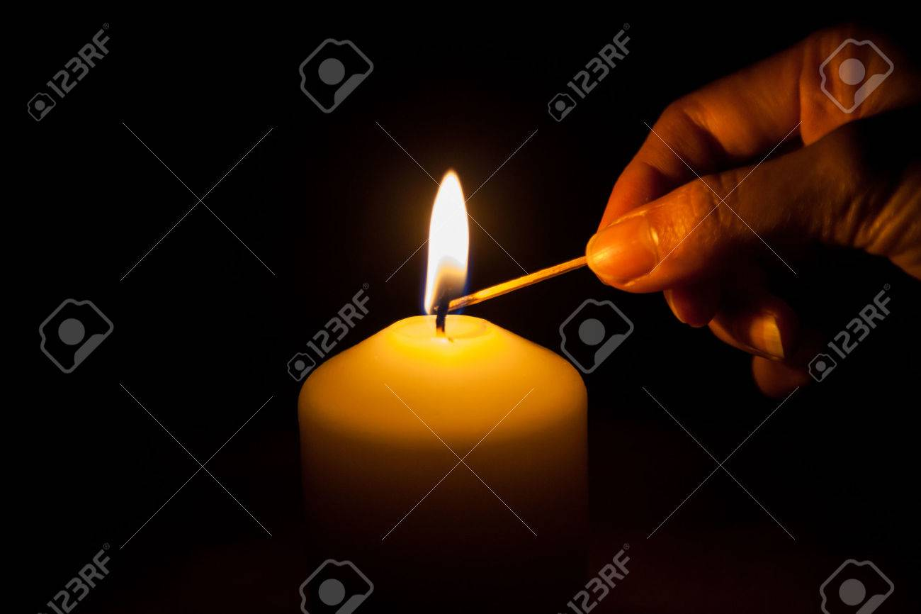 hand lighting. Hand With Matchstick, Lighting A Candle Stock Photo - 39015271 M