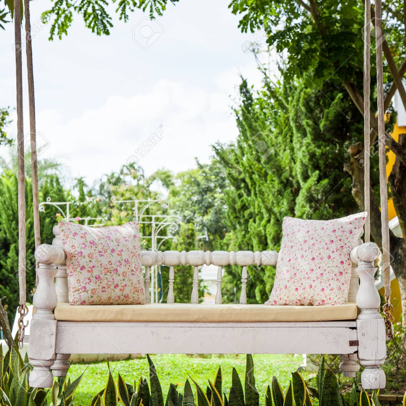 Vintage Swing And Light Pink Flower Pillow Stock Photo Picture And