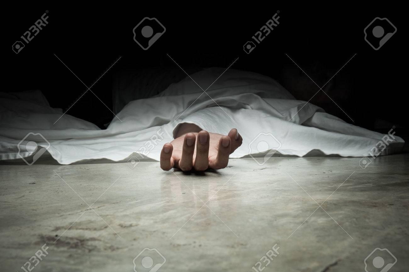 The dead man's body. Focus on hand - 55629597
