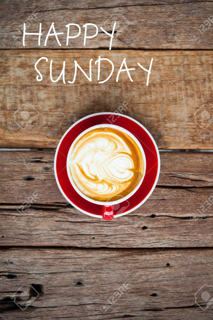 Happy Sunday Word On Red Cup Of Coffee On Wooden Table Stock Photo ... #sundayCoffee