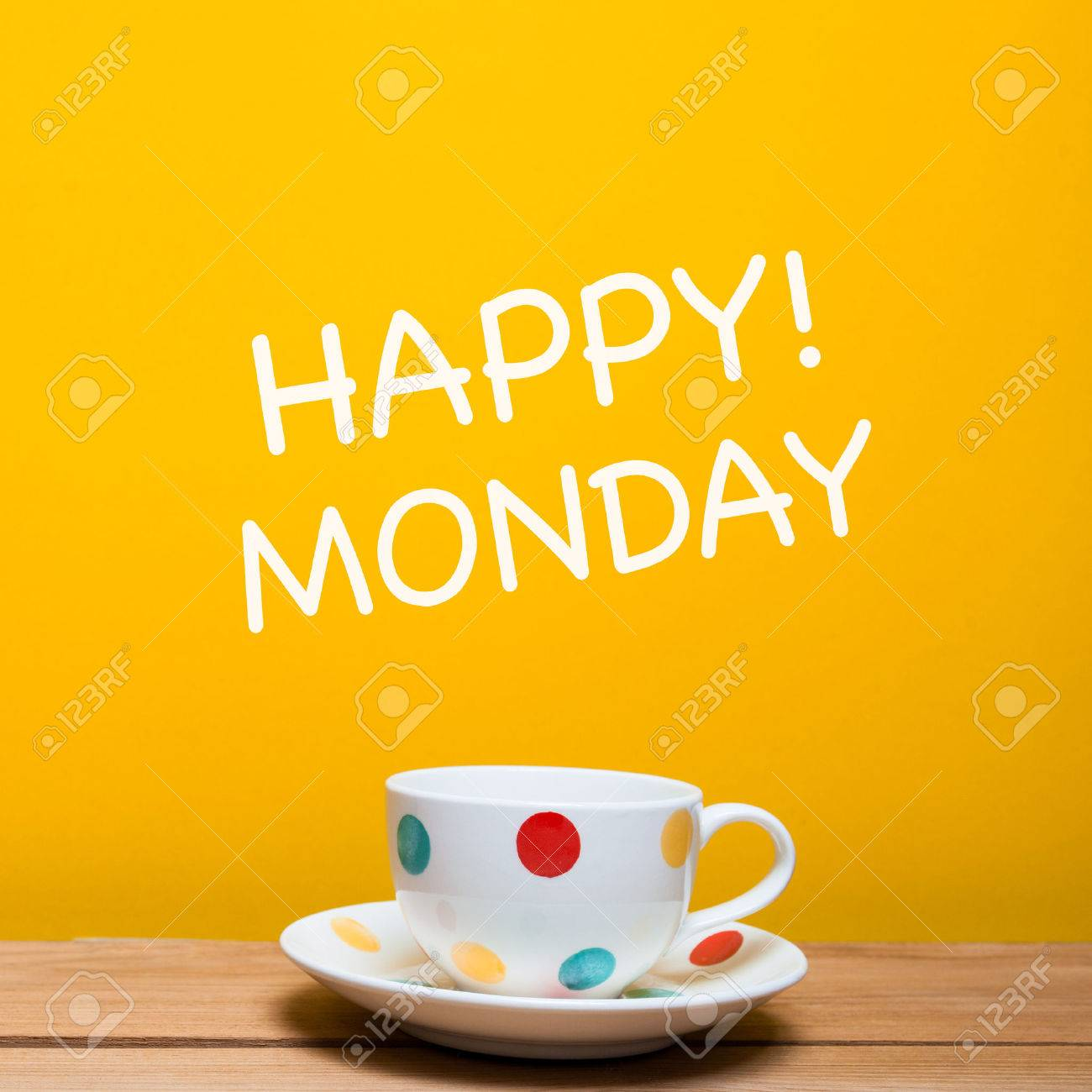 Happy Monday Word With Coffee Cup On Yellow Background Stock Photo
