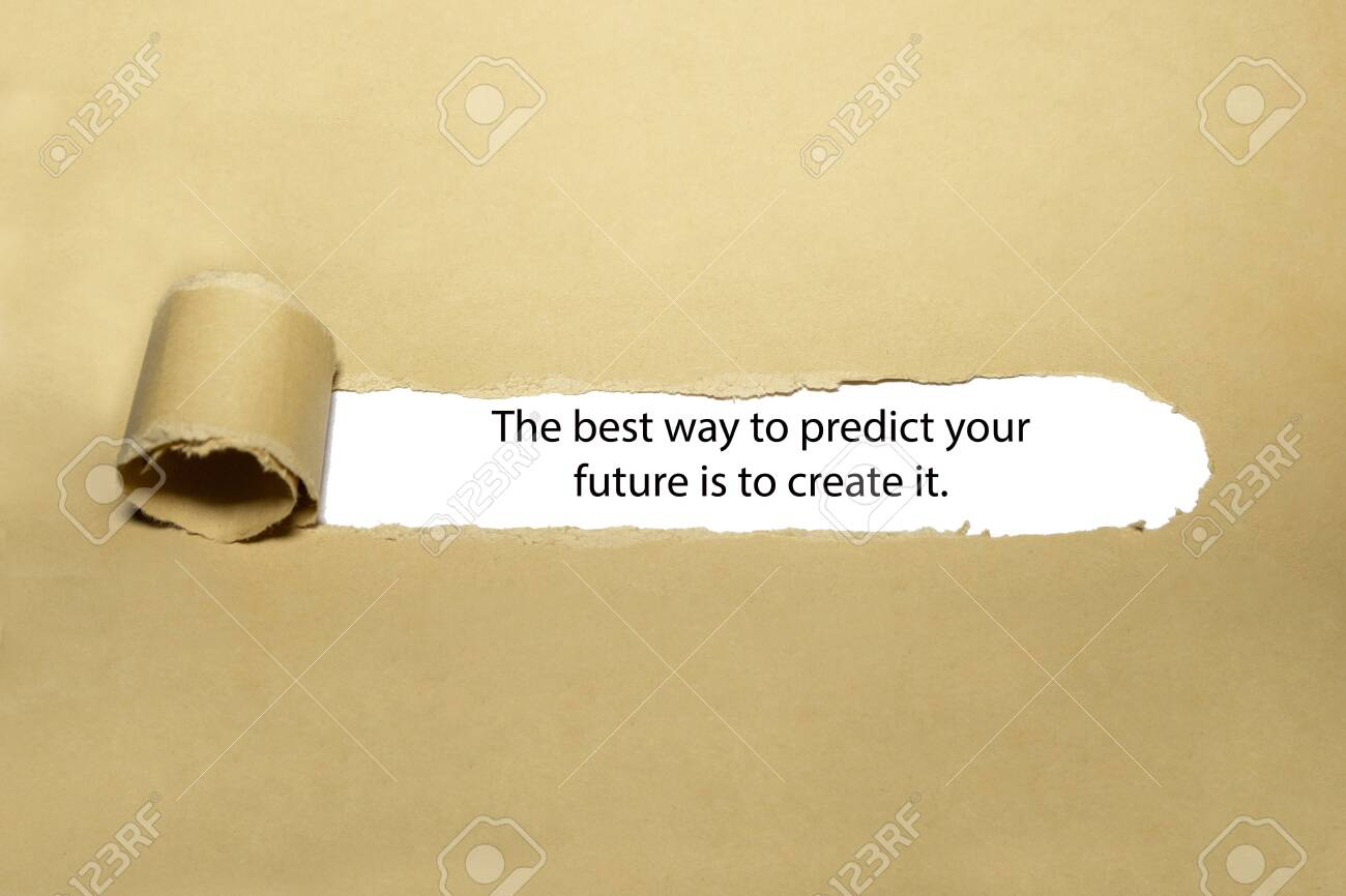Inspirational quote The best way to predict your future is to create it. appearing behind torn brown paper. - 137535696