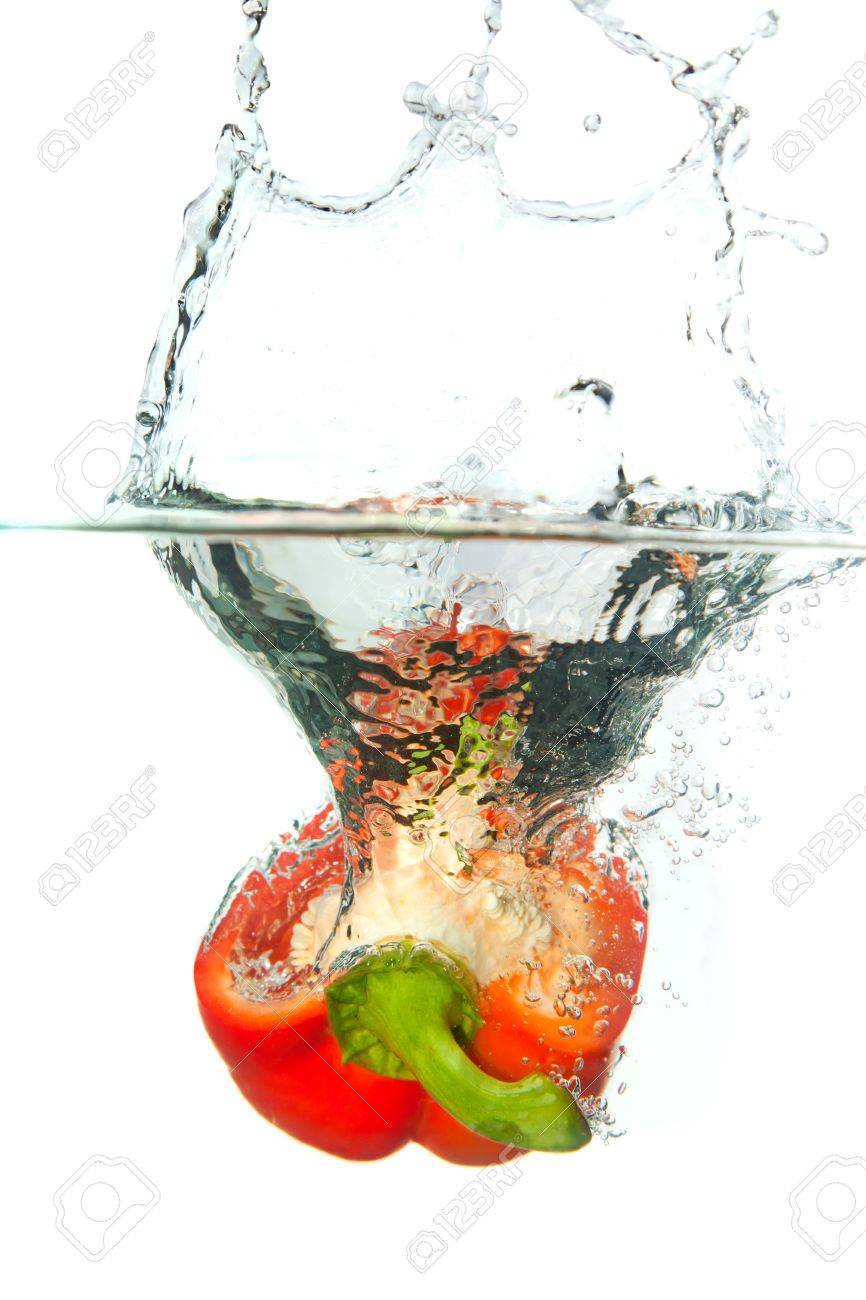 Red paprika in water splash isolated on white background Stock Photo - 9036957