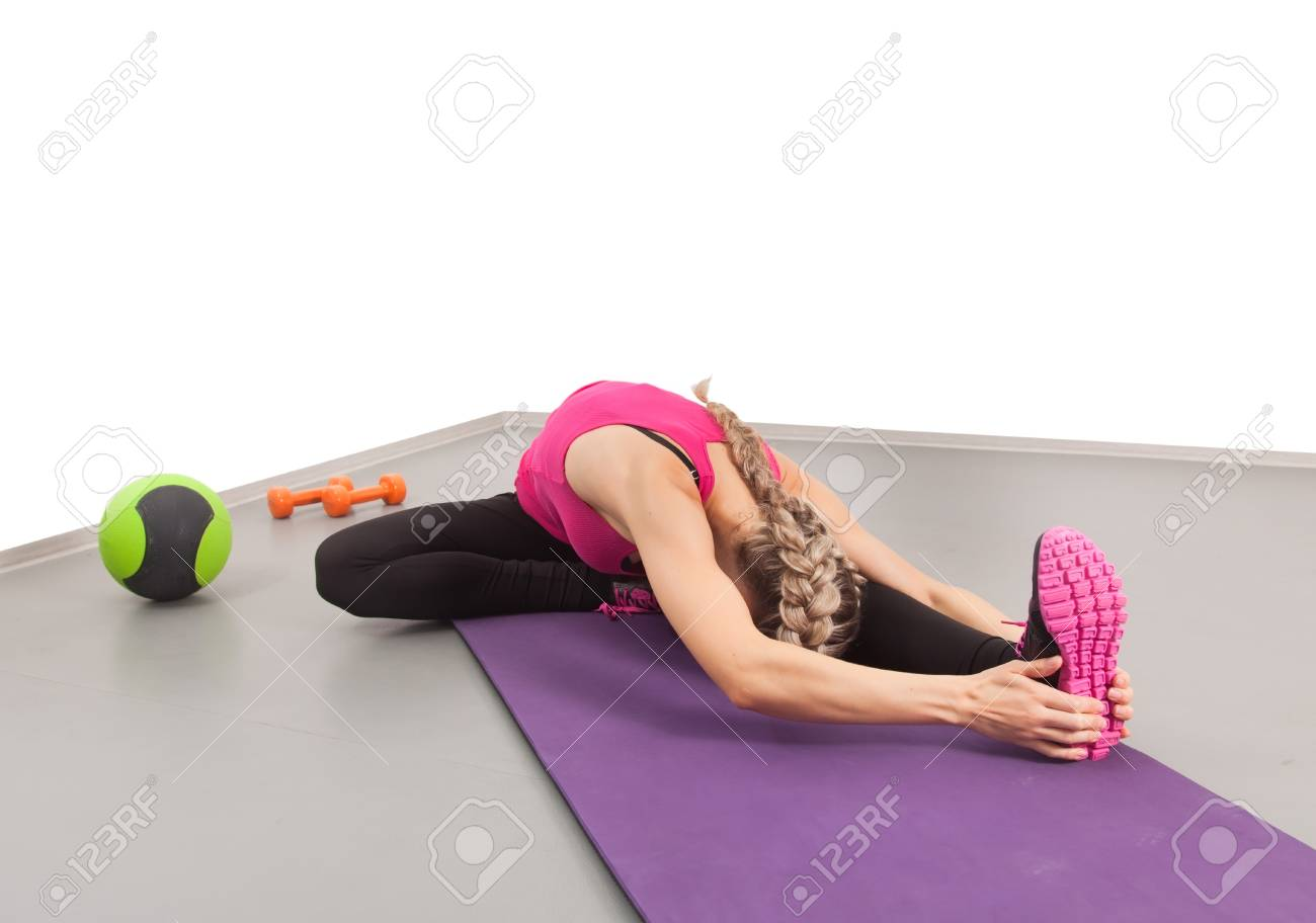 Athletic young woman doing exercises in the gym Stock Photo - 16119318