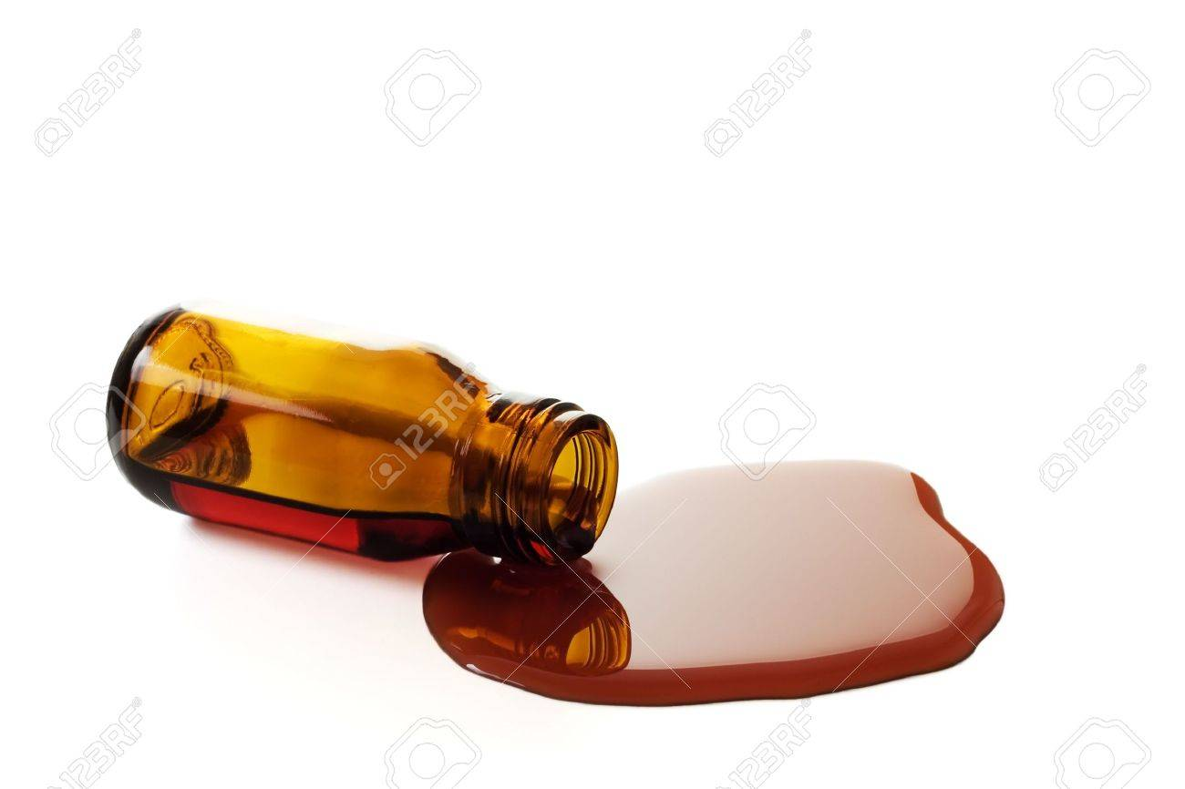 Syrup pouring from a bottle isolated over a white background Stock Photo - 527102