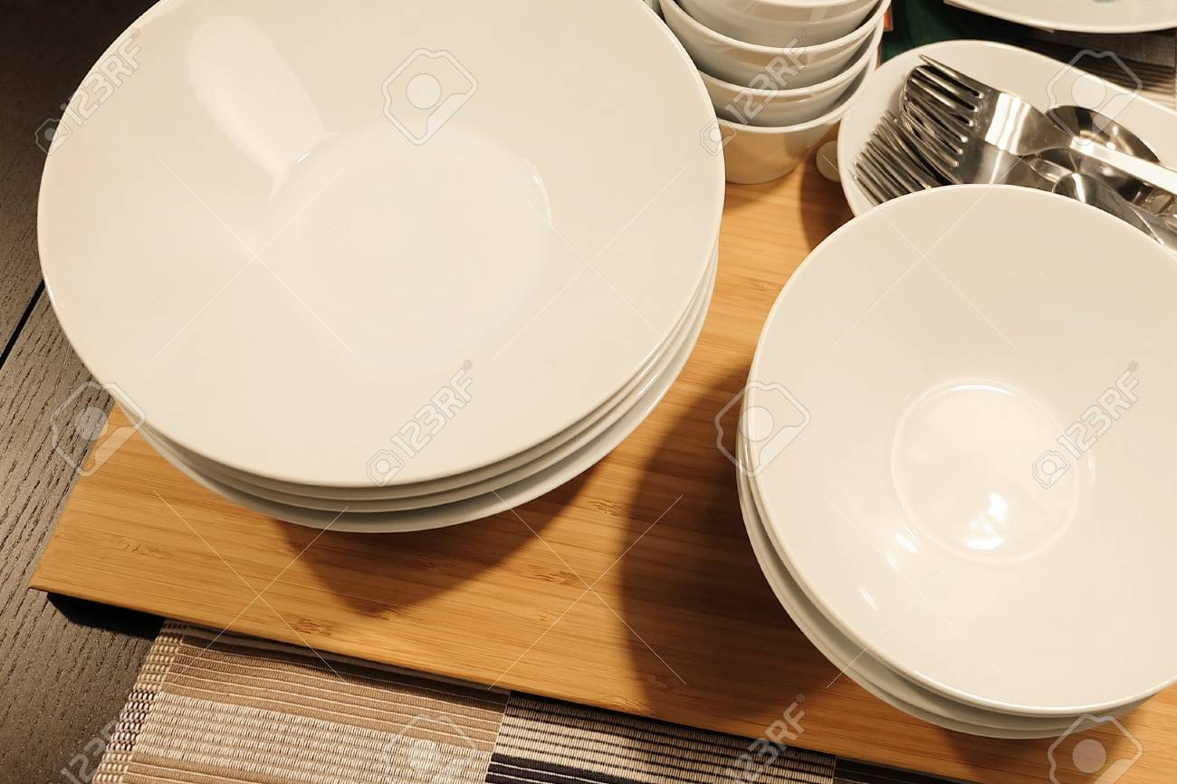 Kitchen Utensil, Collection Of Ceramic Plates, Bowls And Cutlery ...