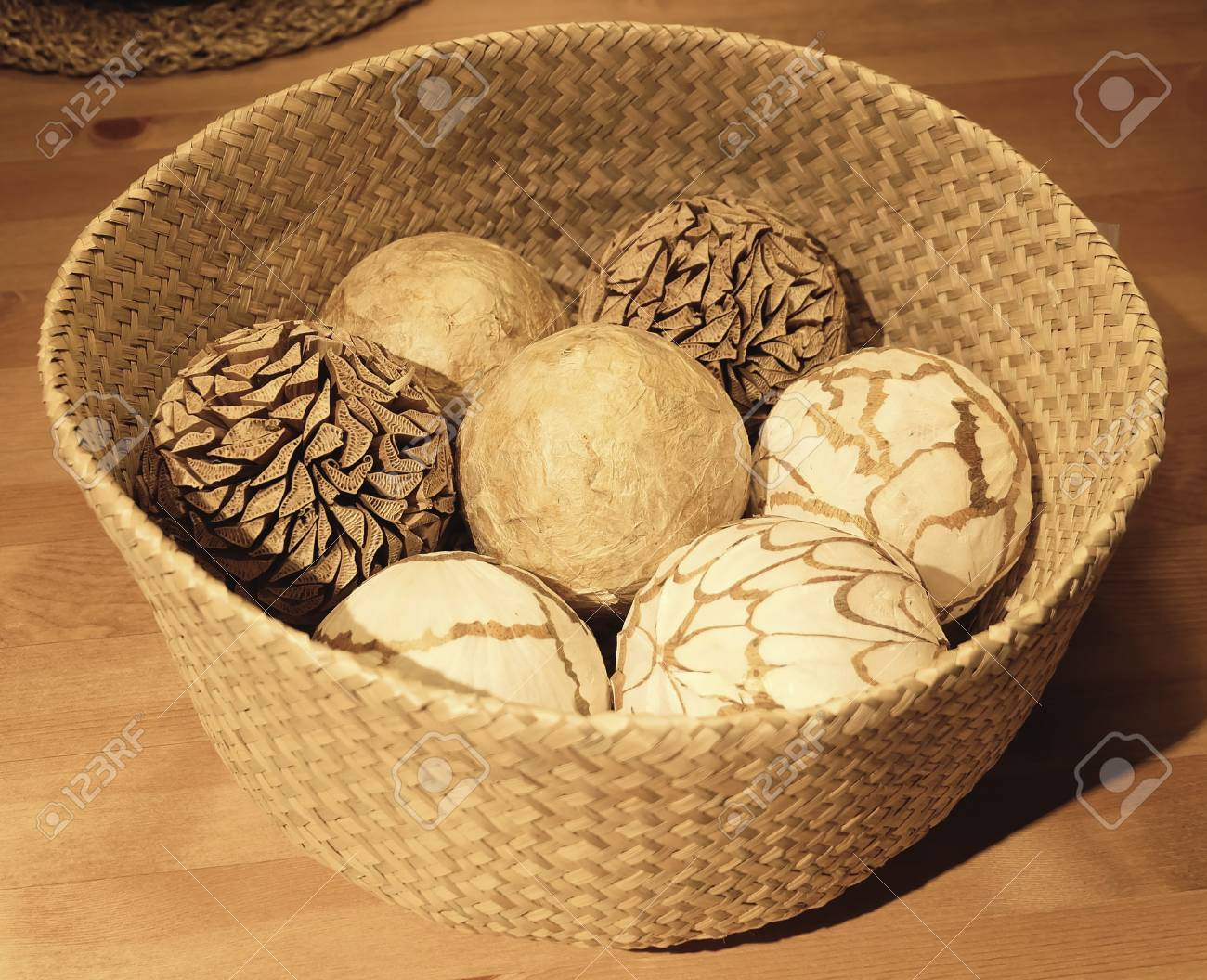 Home Decor Close Up Of Ornamental Decorative Balls In A Woven Wickers Basket Used For