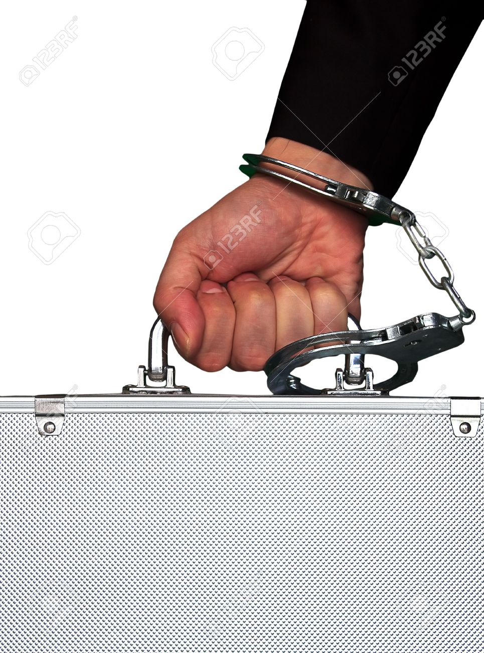 hand with handcuff and a suitcase Stock Photo - 8078203