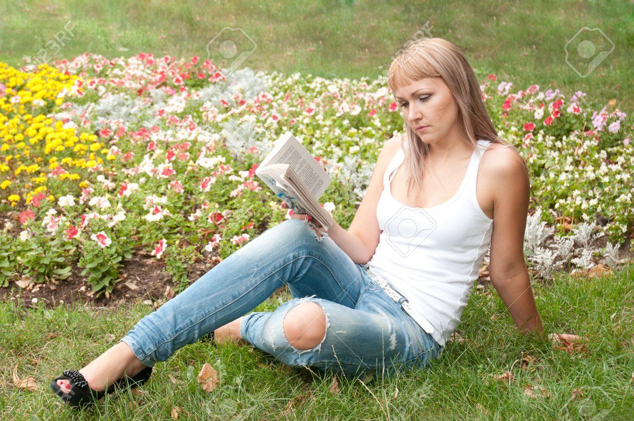Girl In The Garden Reading A Book Stock Photo   10330627