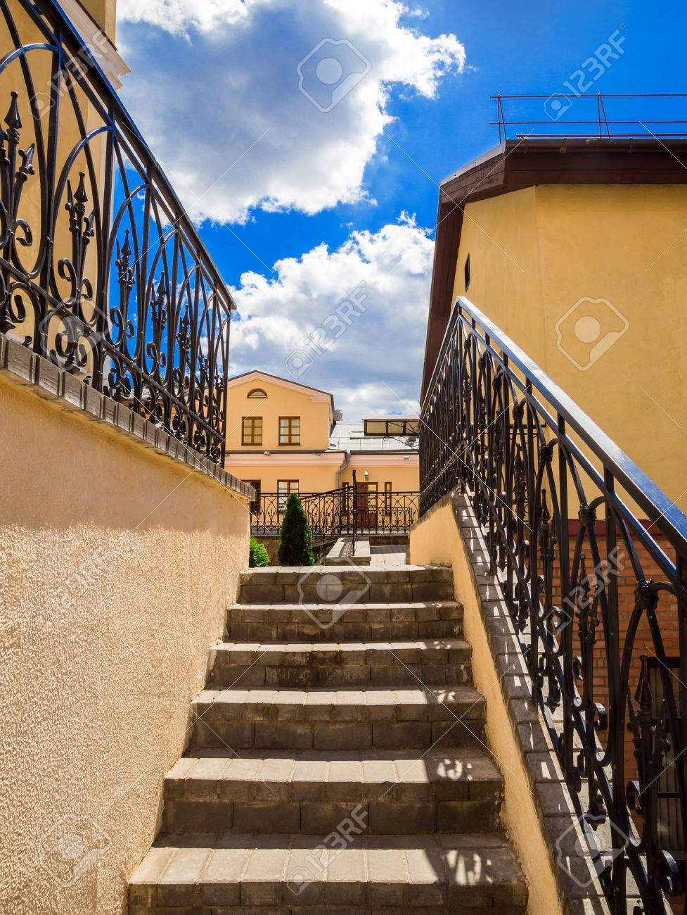 Old Stairs Of Concrete Outdoors Black Steel Railing With A Yellow Stock Photo Picture And Royalty Free Image Image 65823135