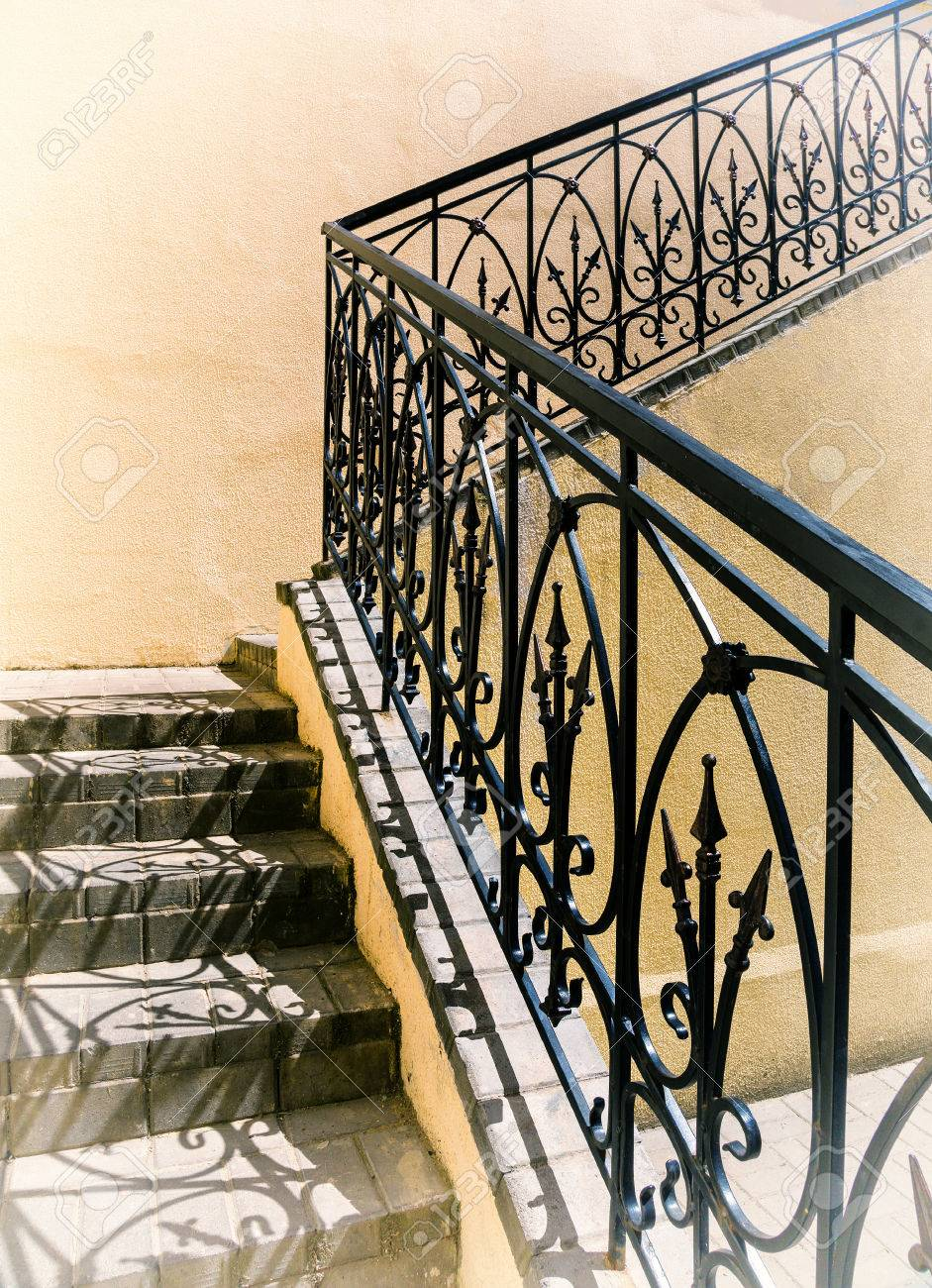 Old Stairs Of Concrete Outdoors Black Steel Railing With A Yellow Stock Photo Picture And Royalty Free Image Image 65823240
