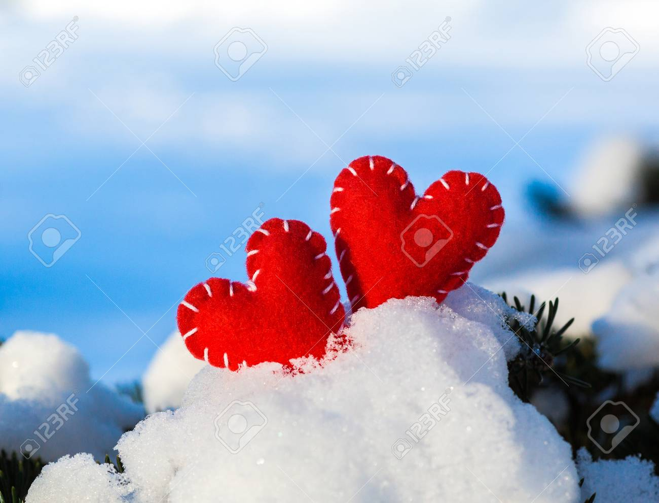 Red textile heart on fresh white snow a symbol of love red textile heart on fresh white snow a symbol of love valentines day biocorpaavc Images