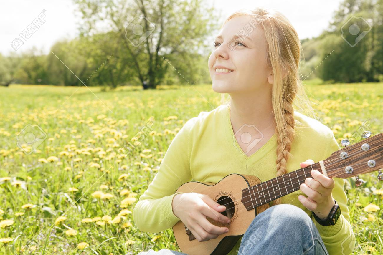 the girl plays a guitar close up stock photo picture and royalty