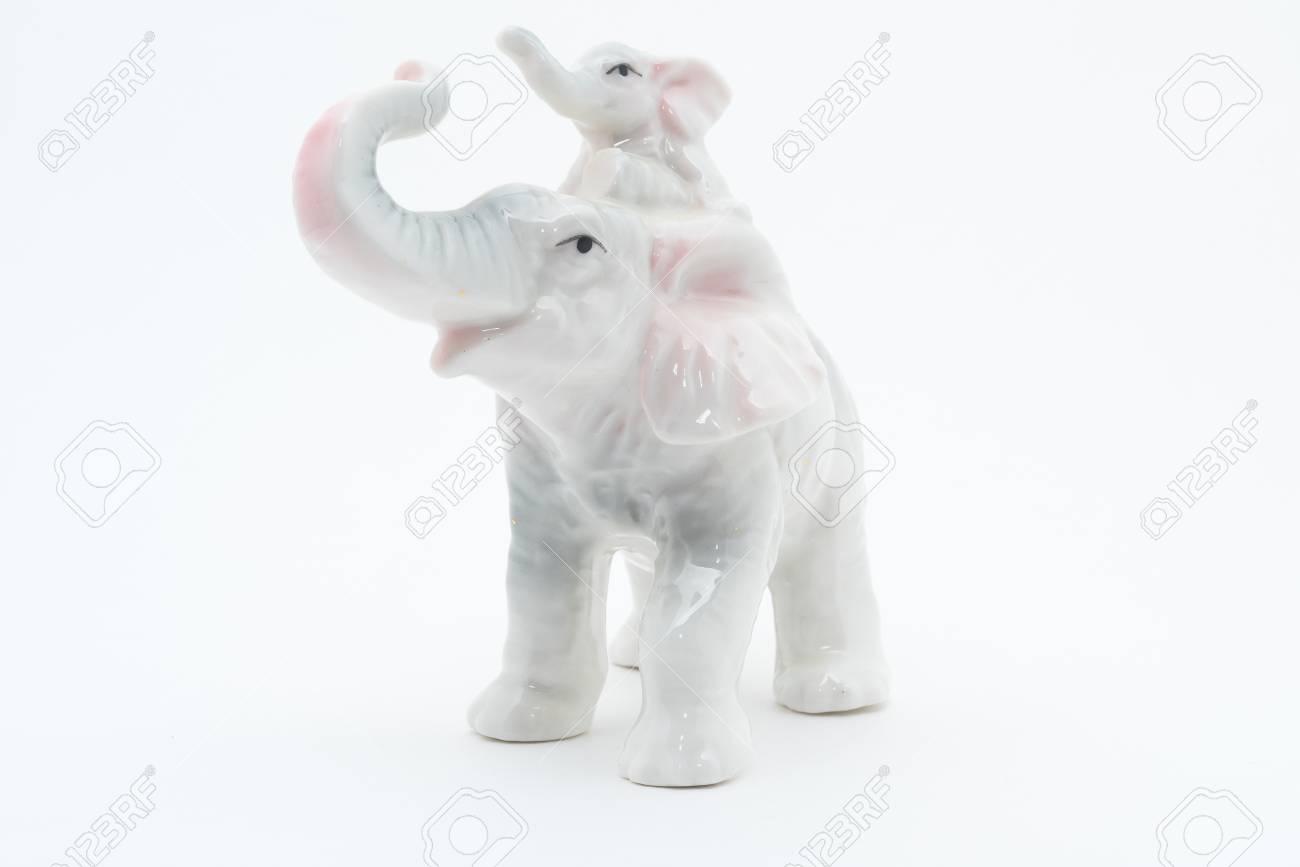 Porcelain elephants  Isolated on white background