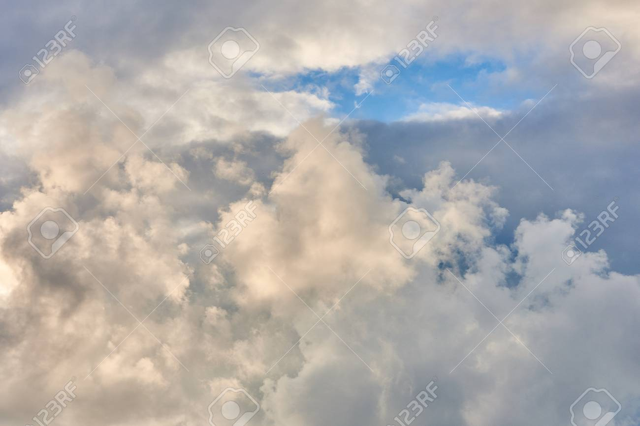 White feathery, volumetric clouds  With the sun  For any purpose