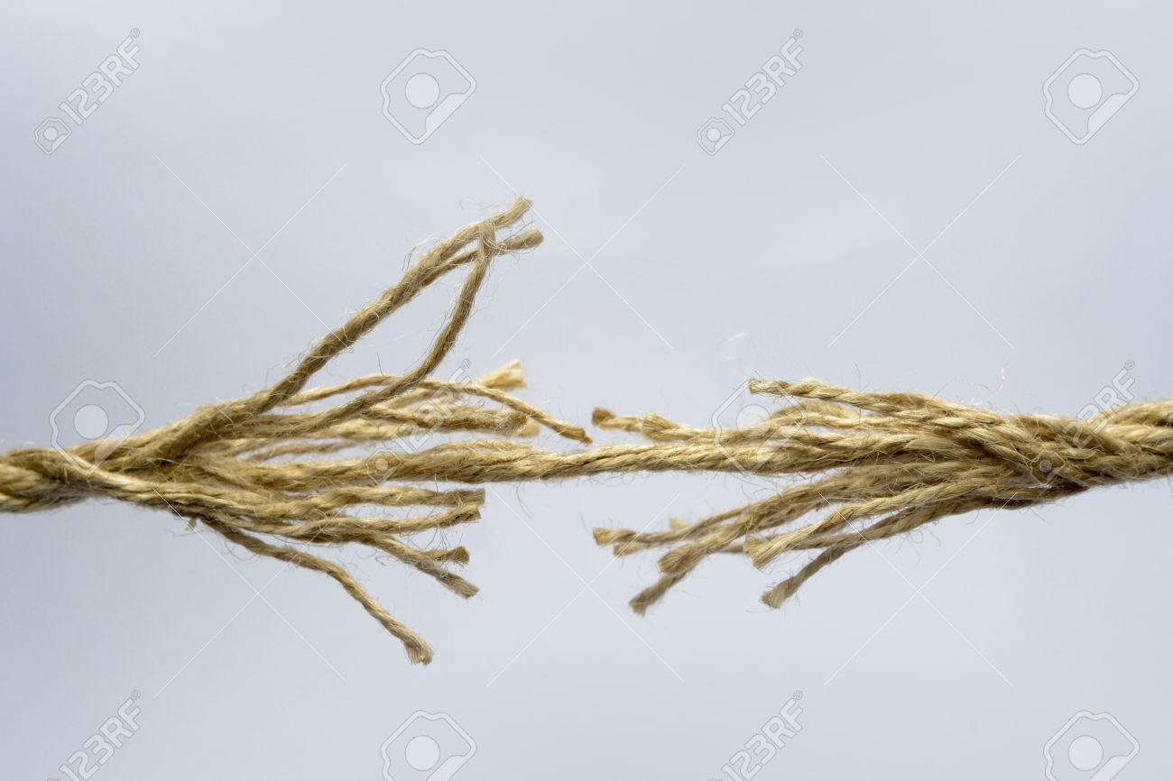 Broken rope on grey background. - 12011277