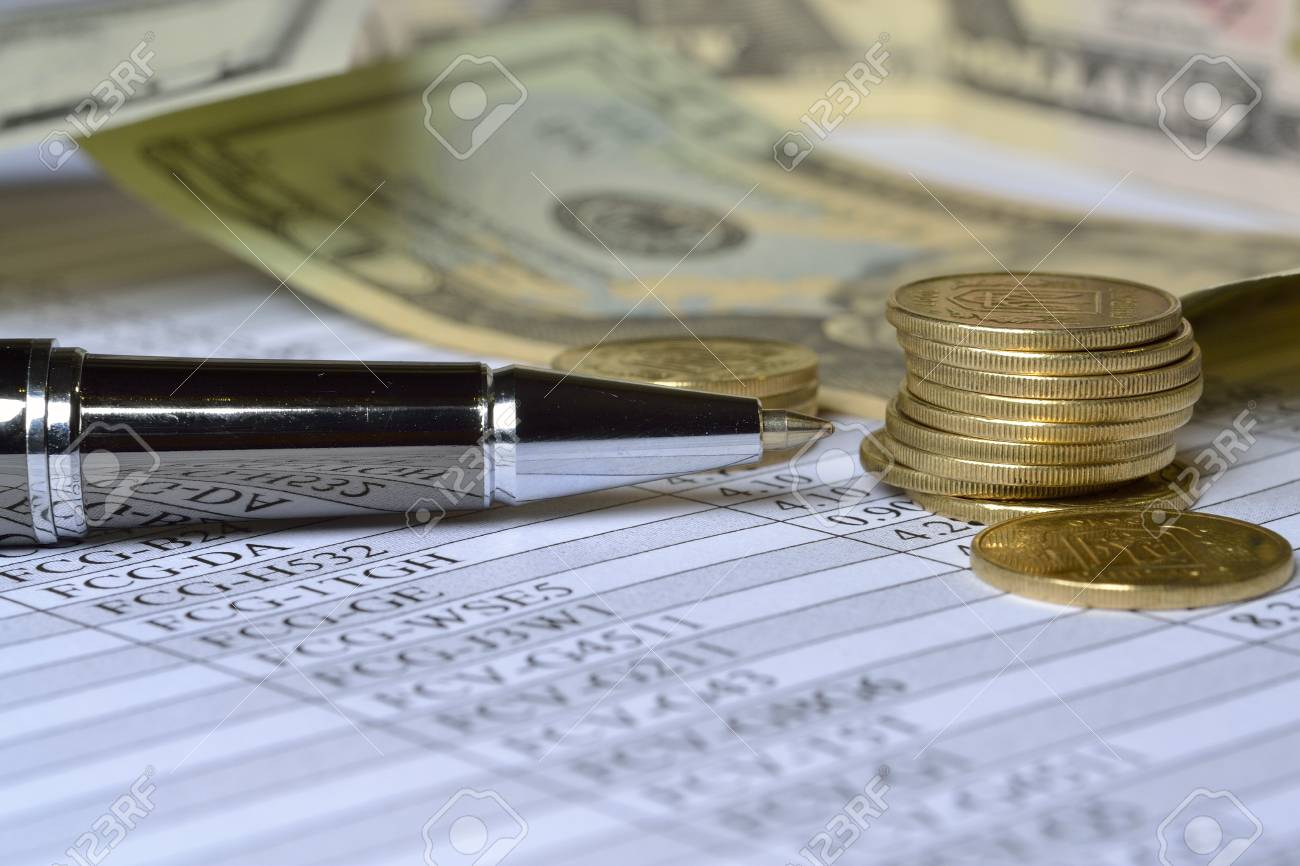 Business background with table, coins and pen. Stock Photo - 12635761