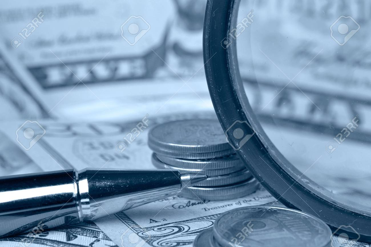 Business background with table, coins and pen, background in blues. Stock Photo - 13400695
