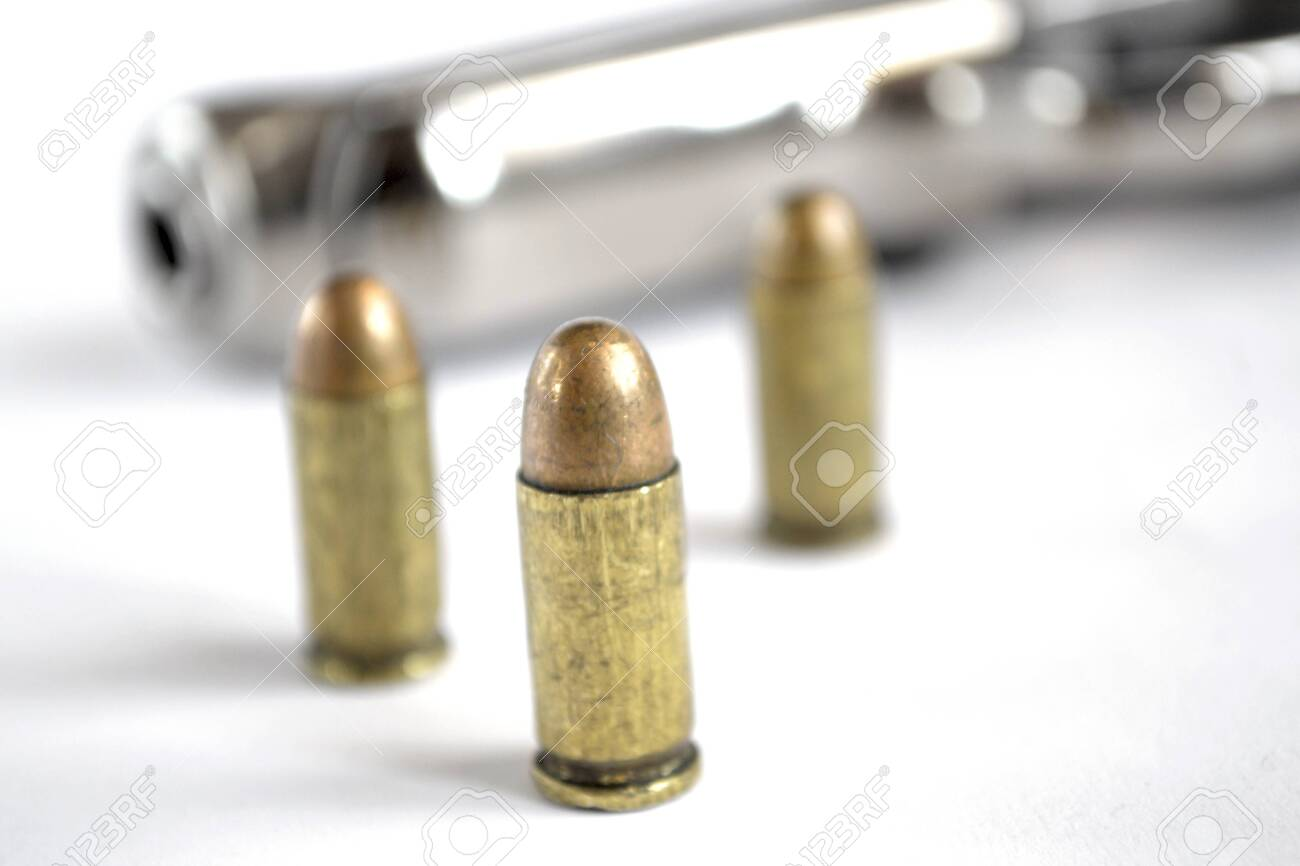 Pistol and ammunition on the white background. - 122120890