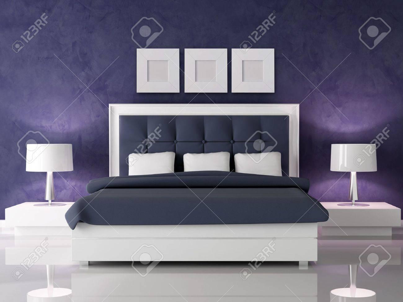 fashio white and navy blue bedroom against dark purple stucco..
