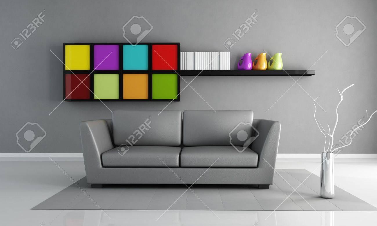 Grijze leren bank en gekleurde kabinet in een minimalistisch wonen ...