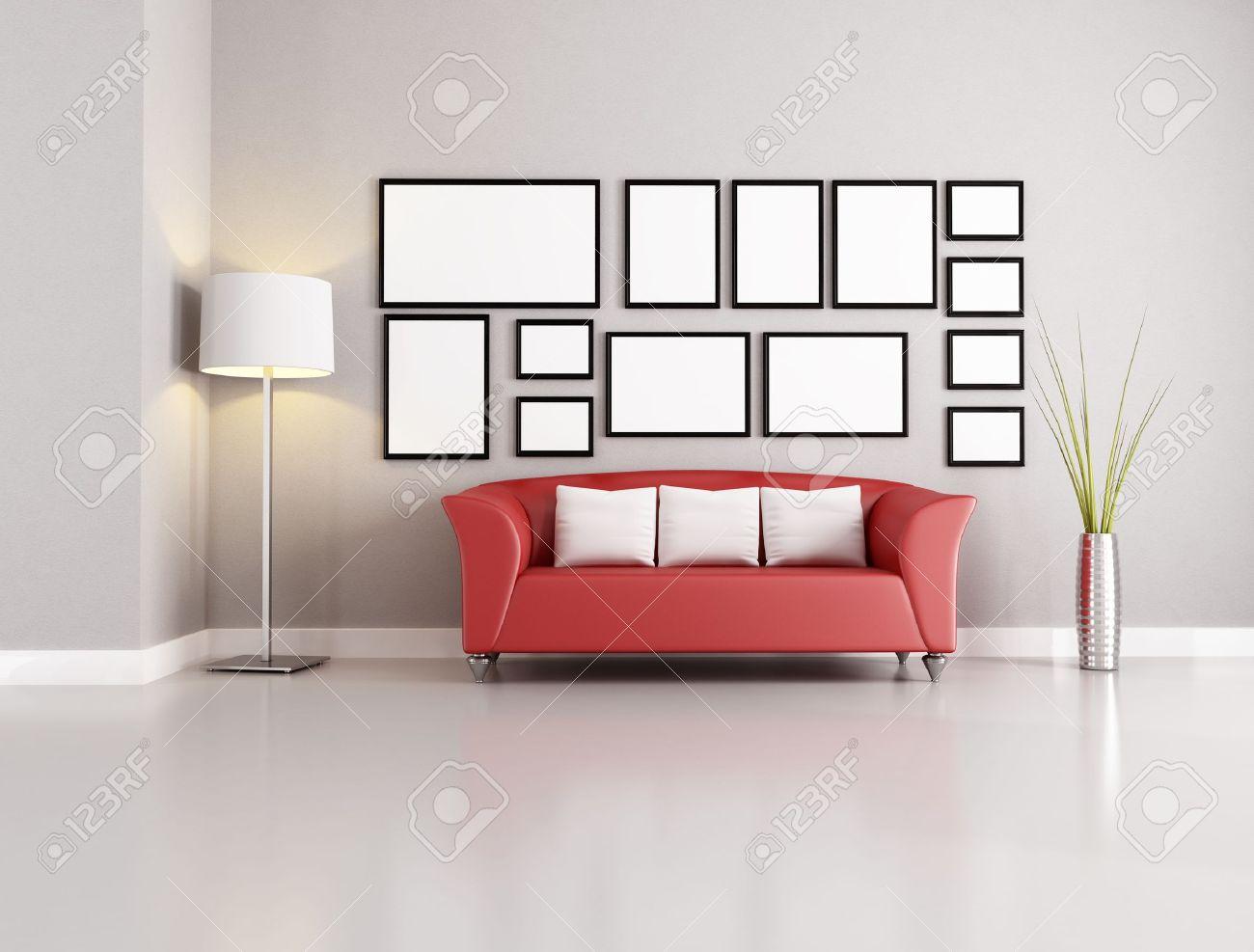 Canapé rouge dans salon moderne avec des cadres vides