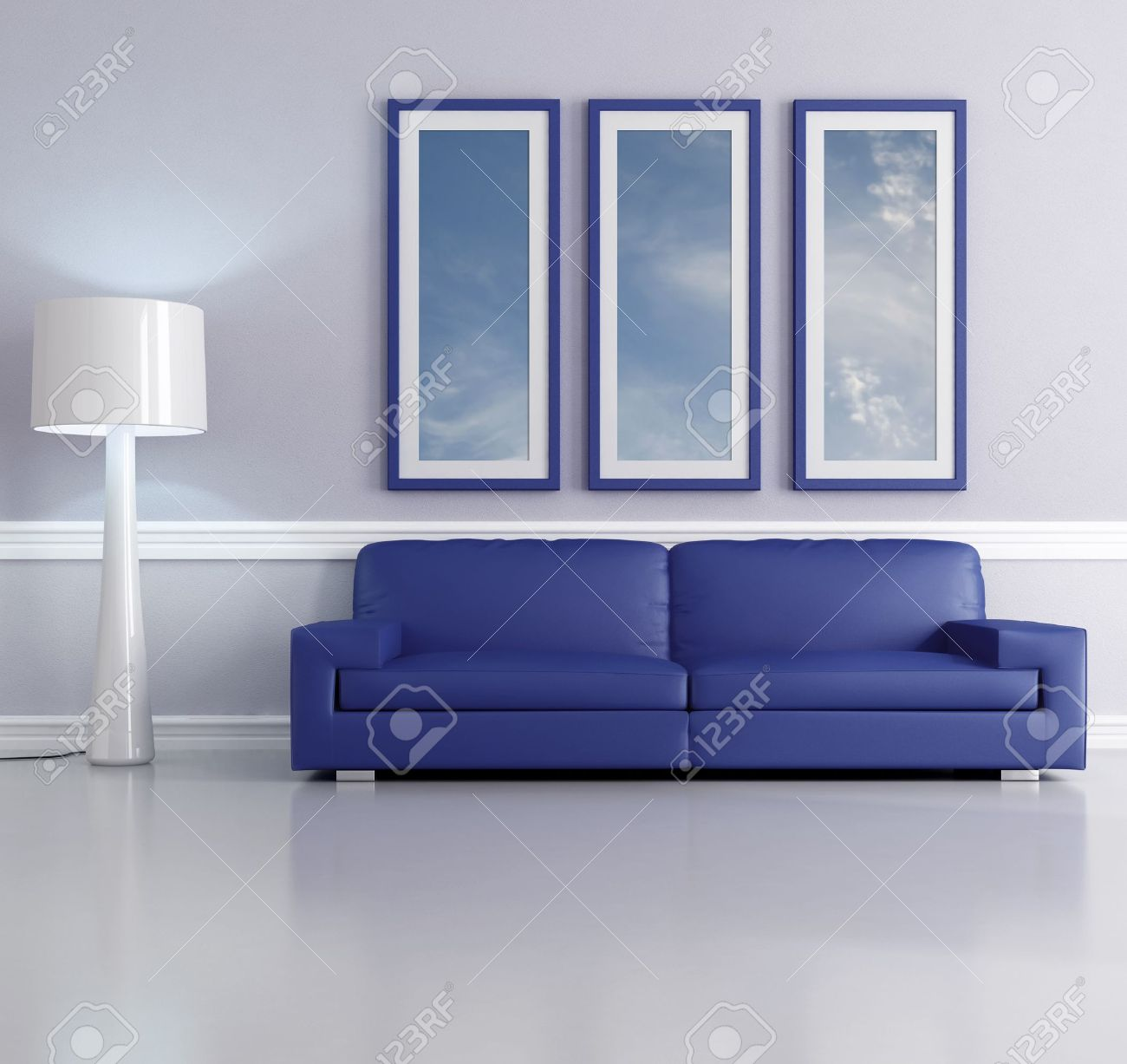 Blue Sofa In A Living Room With Lamp And Picture Frame