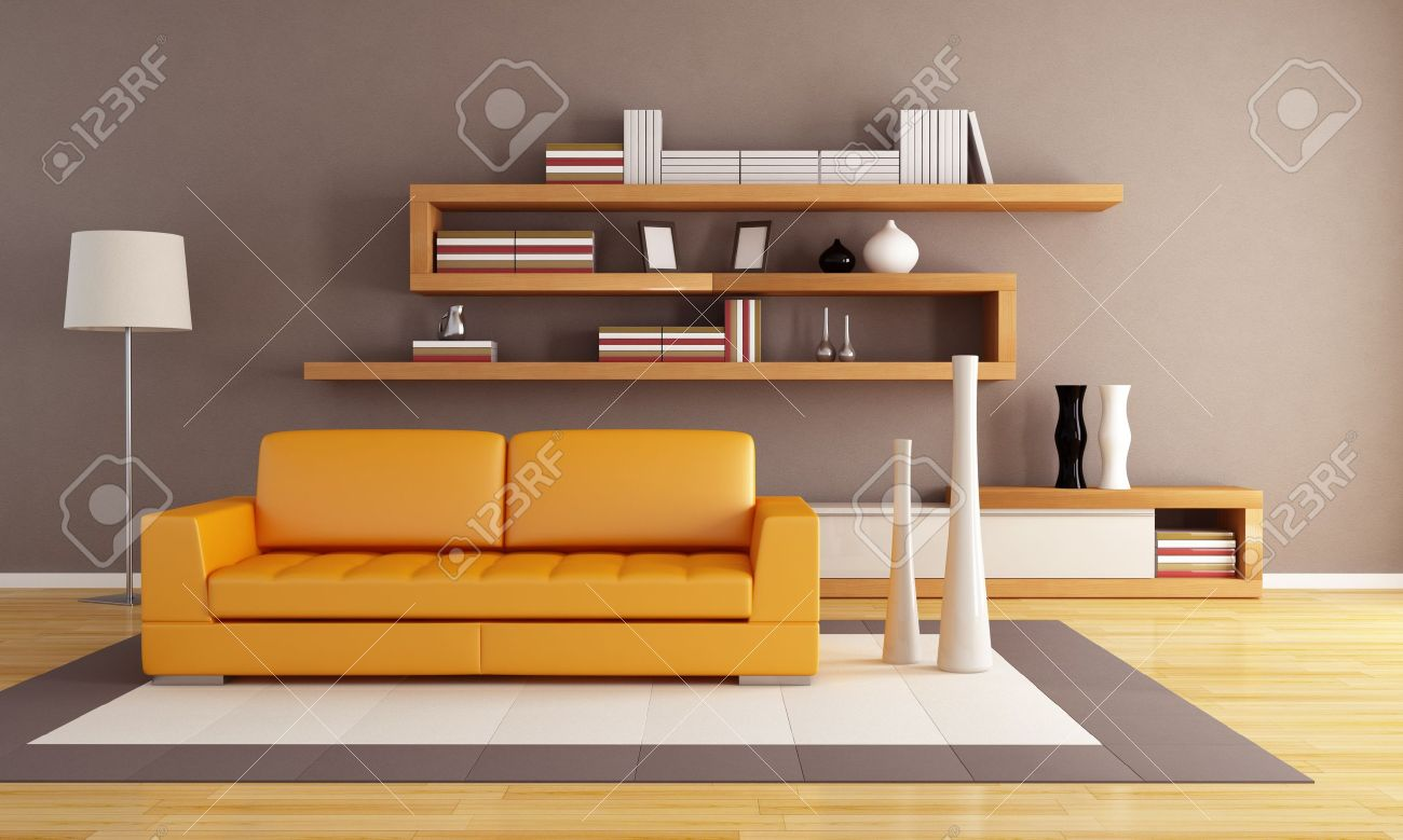 Orange And Brown Living Room With Modern Wooden Bookshelf Stock Photo
