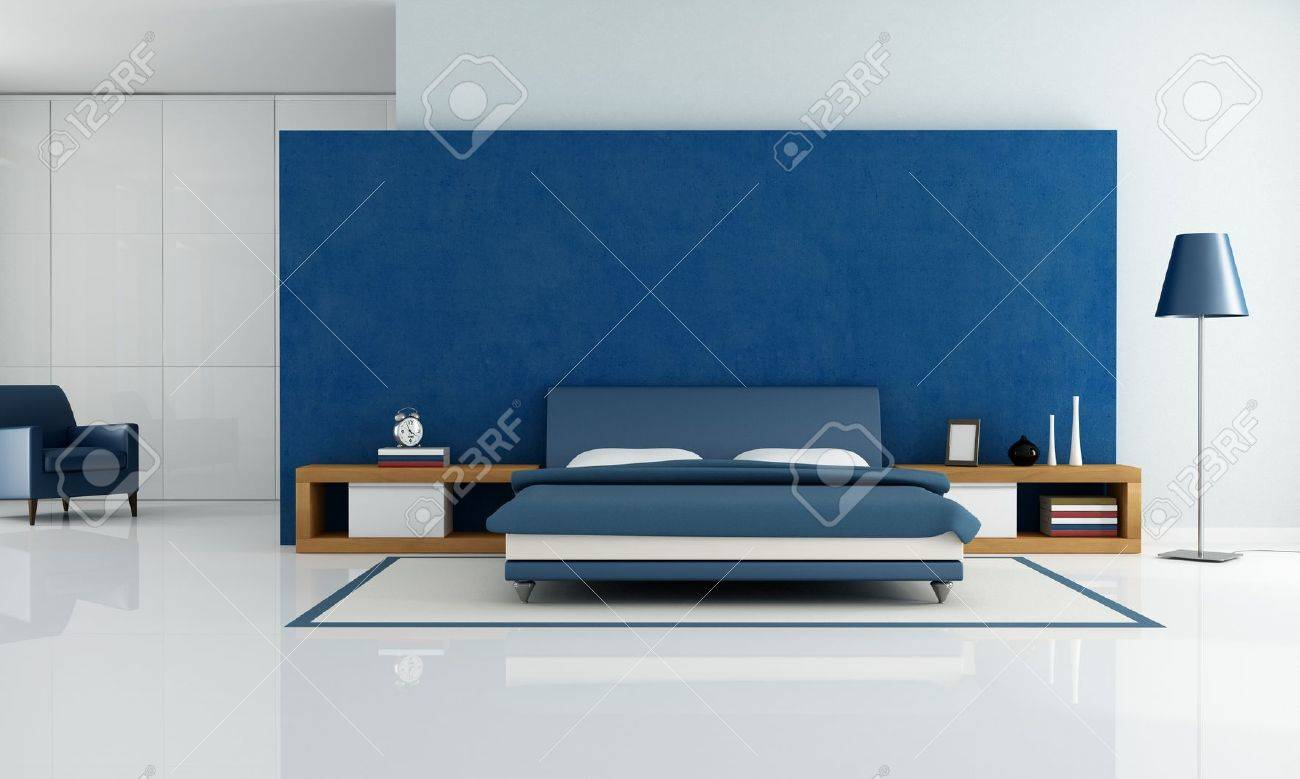 contemporary blue bedroom with white wardrobe and armchair -..