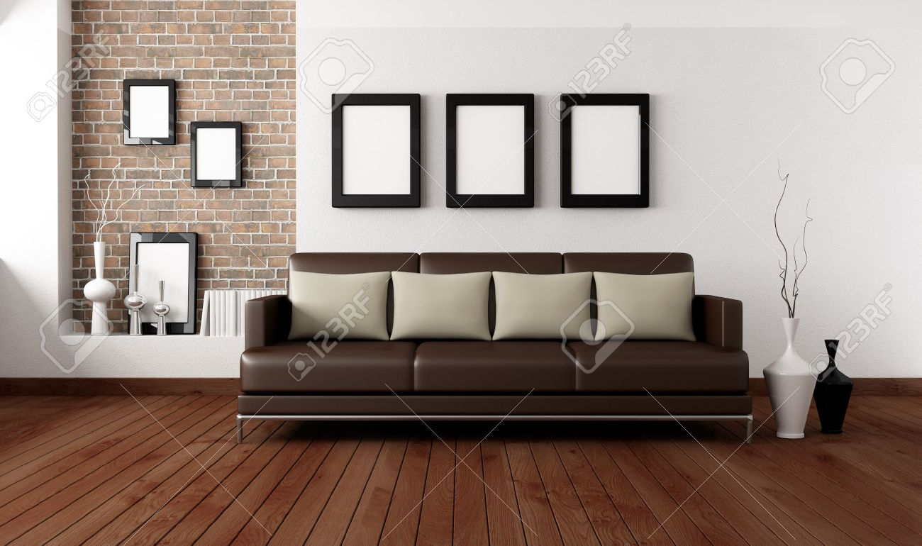 Brown Sofa With Pillow In Front A White Wall And Brick Niche Stock Photo