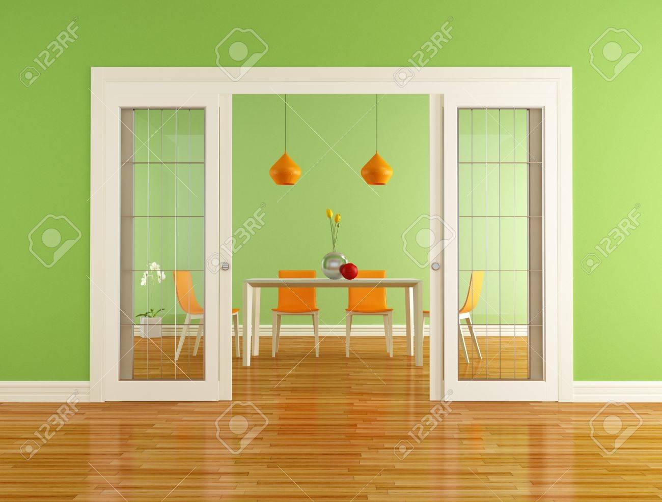 Green And Orange Dining Room With Open Sliding Door
