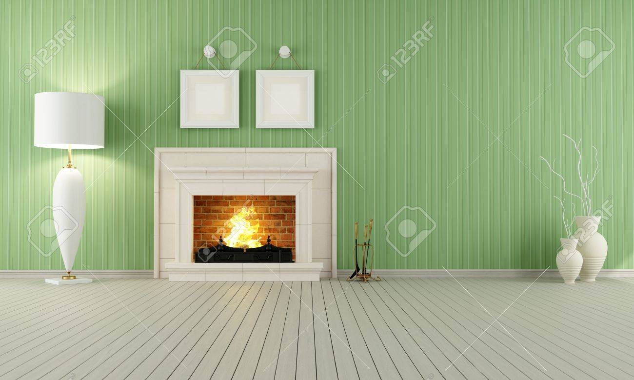 vintage interior with green wallpaper and classic fireplace stock